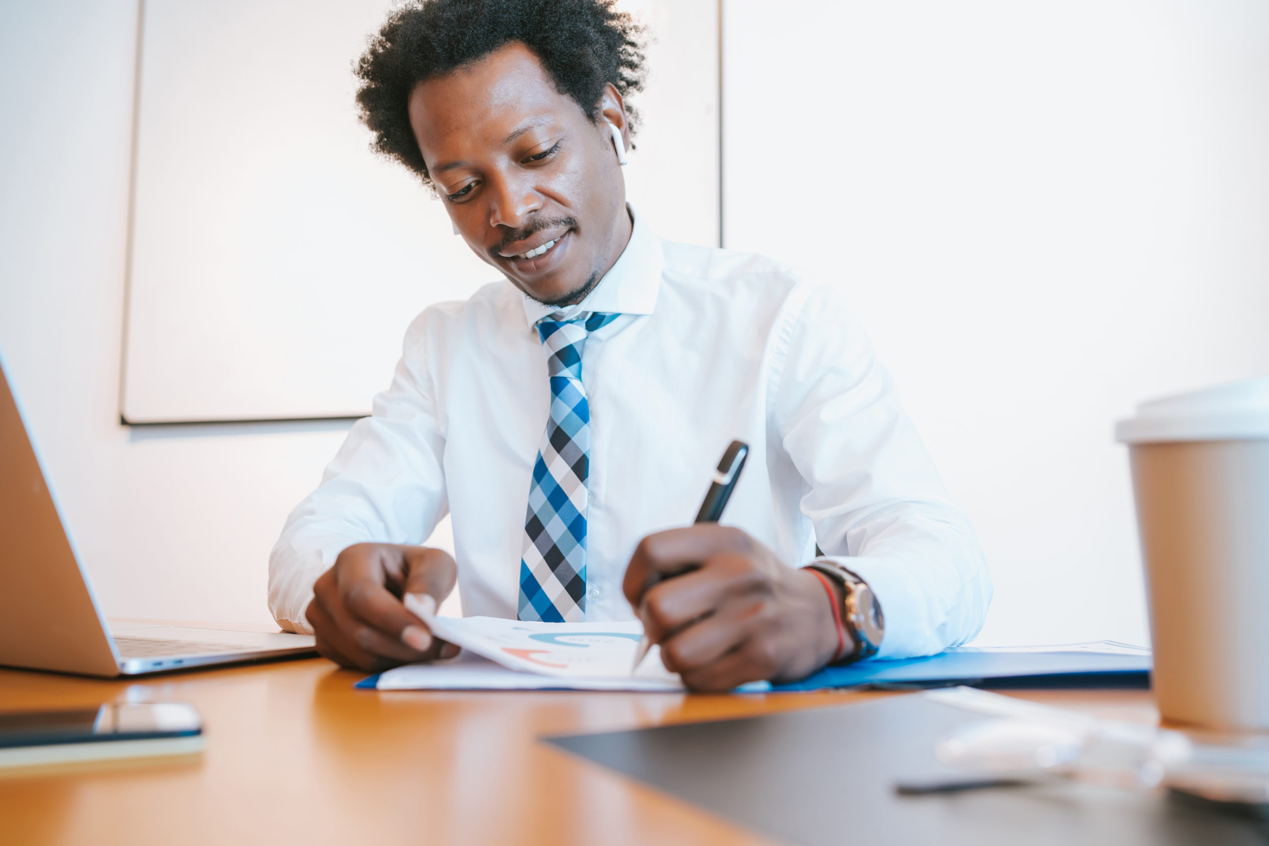Professional businessman working at his modern office. Business and success concept.